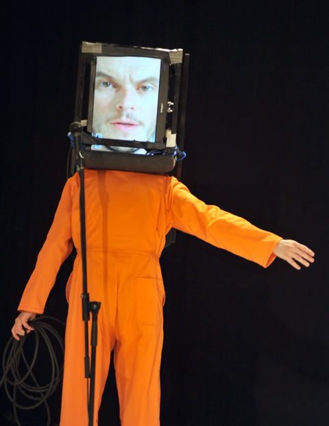 performer in a orange suit