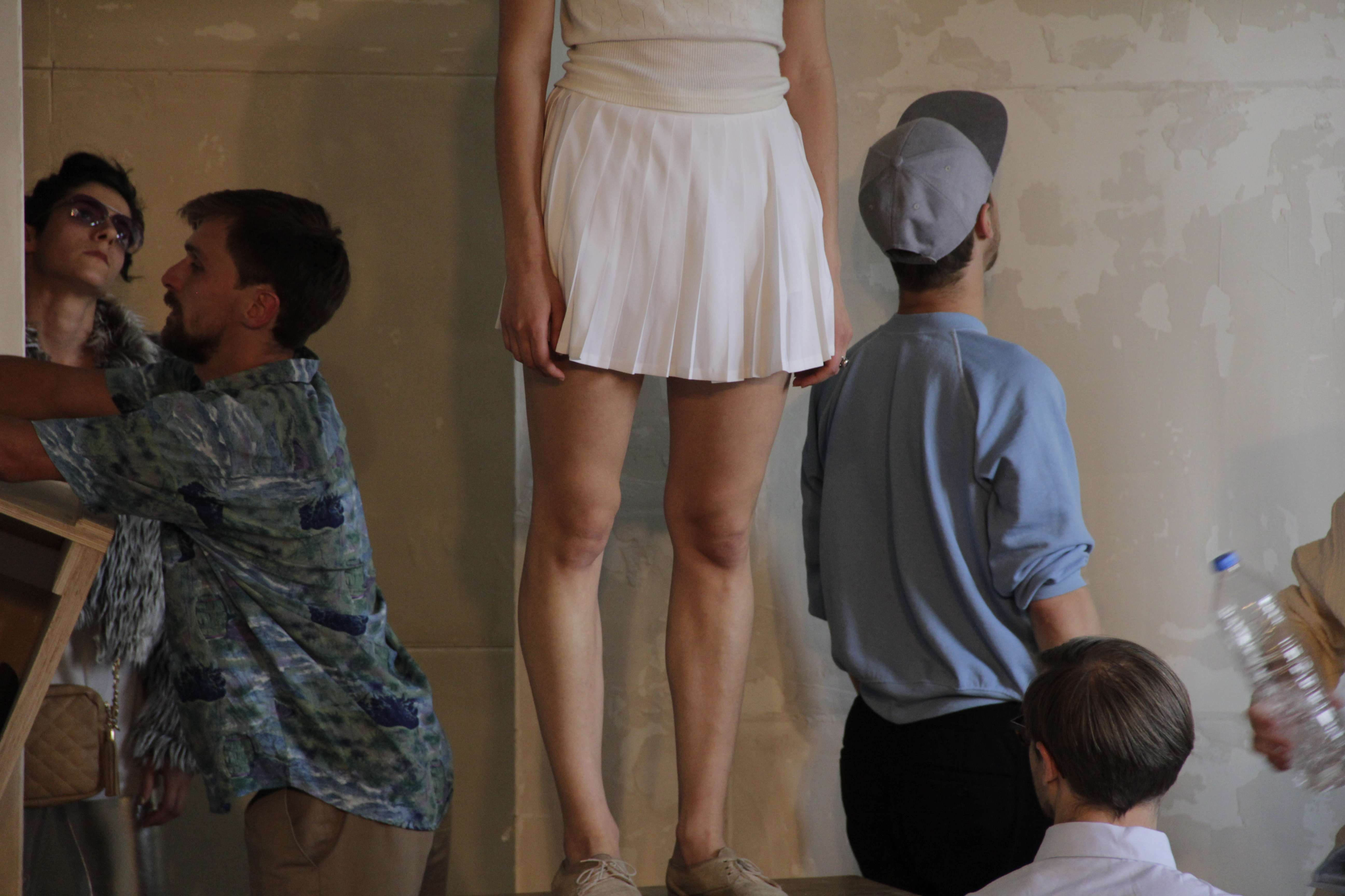 woman in a skirt and other performers of the eternal return